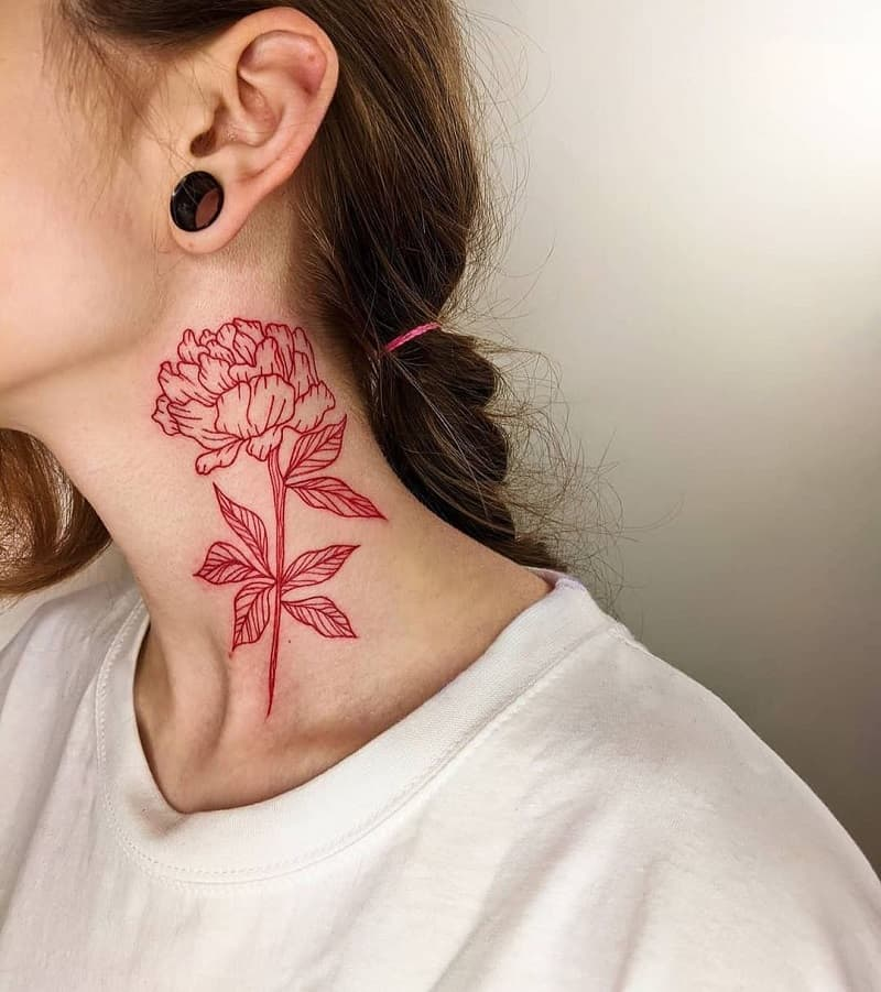 Red tattoo on the neck of women