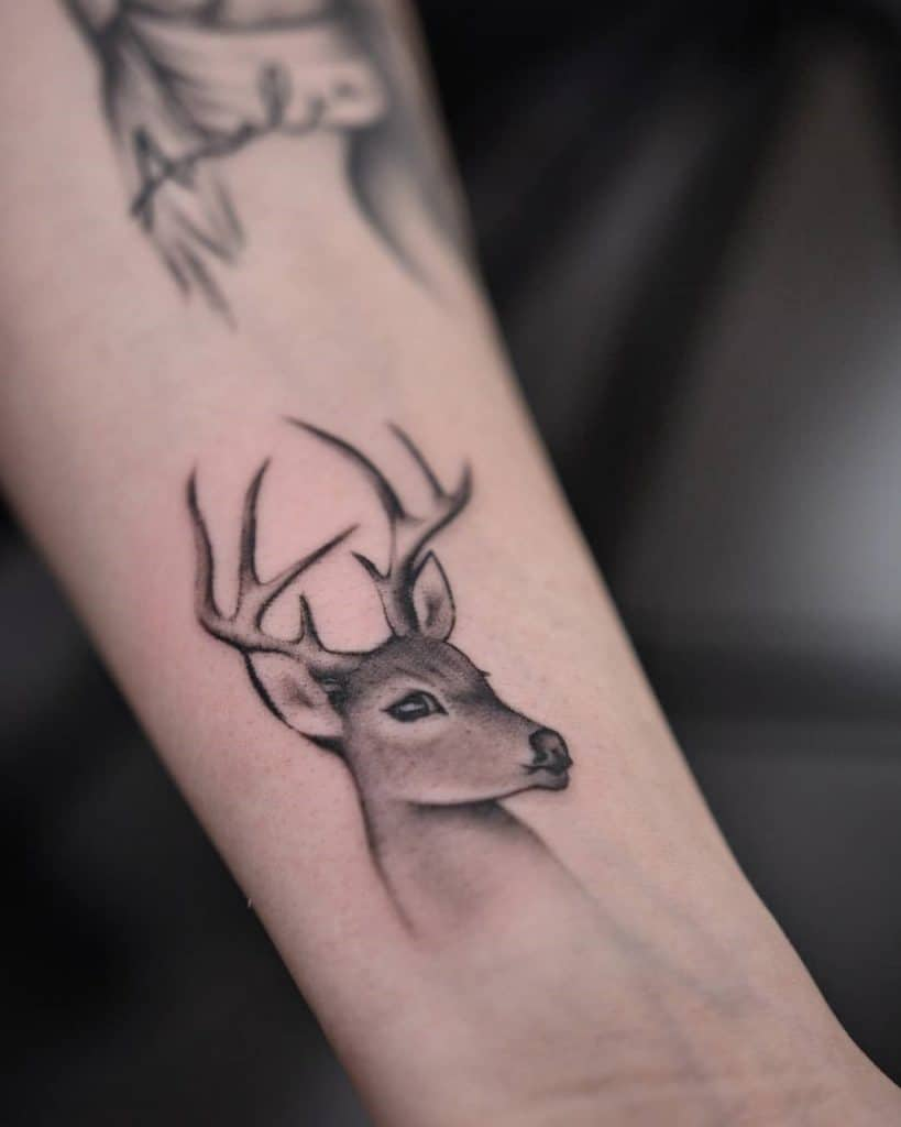 A sitting deer tattoo