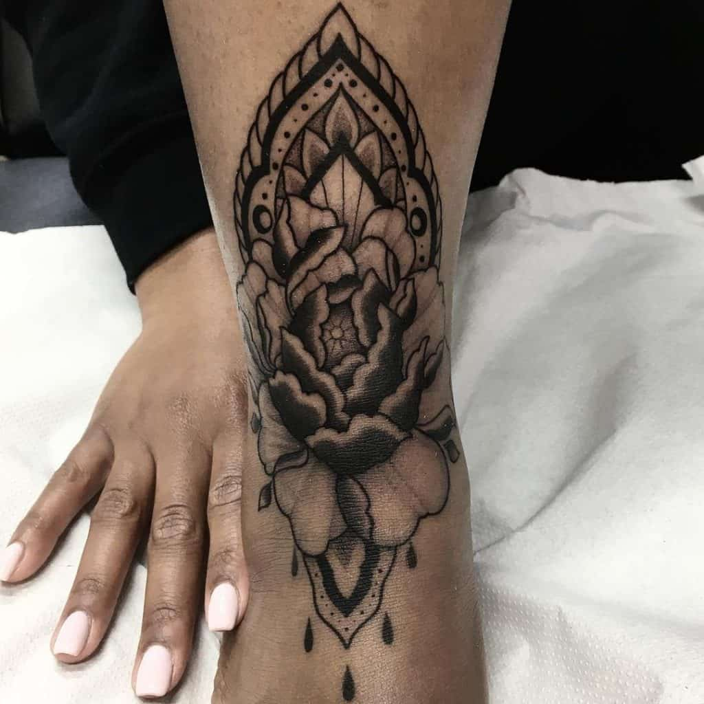 Black & Precise Mandala Foot Tattoo Ideas