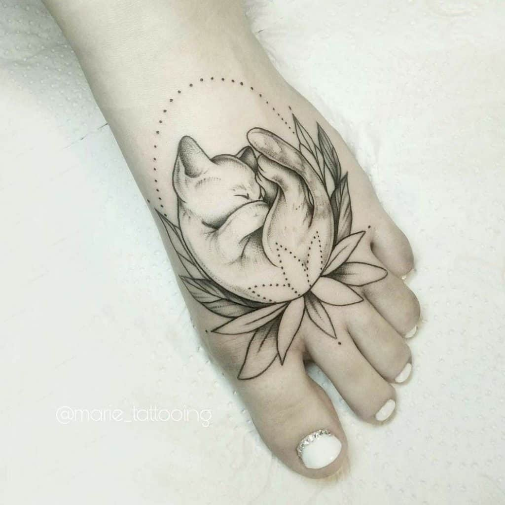 Cute & Artsy Black Foot Tattoo
