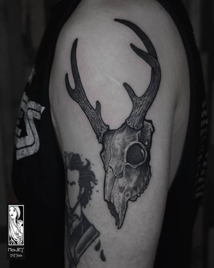 Deer Head Tattoo on The upper arm area