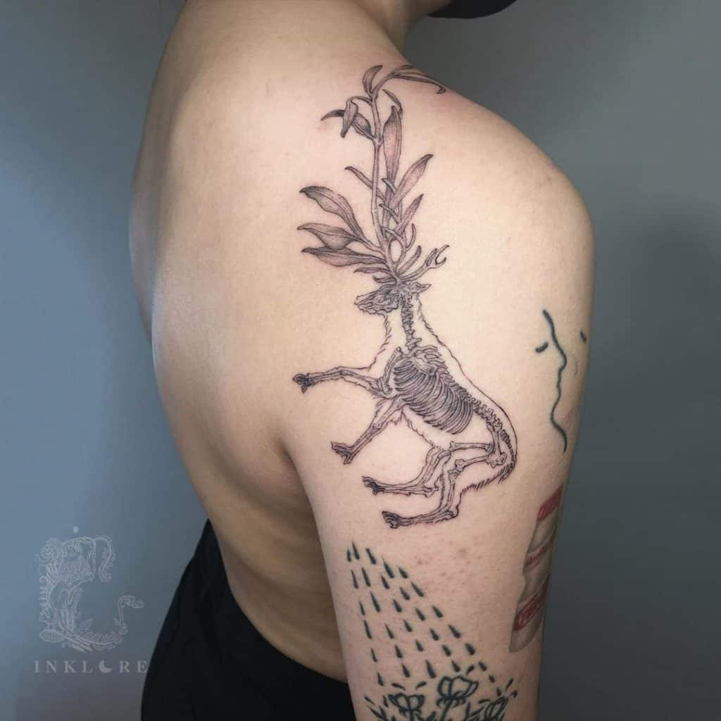 Deer tattoo on the upper back shoulder area