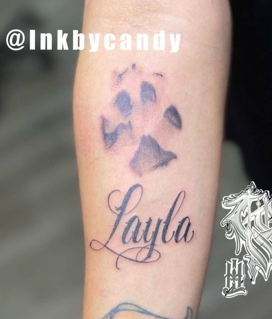 Dog Paw Tattoo With A Name of Layla
