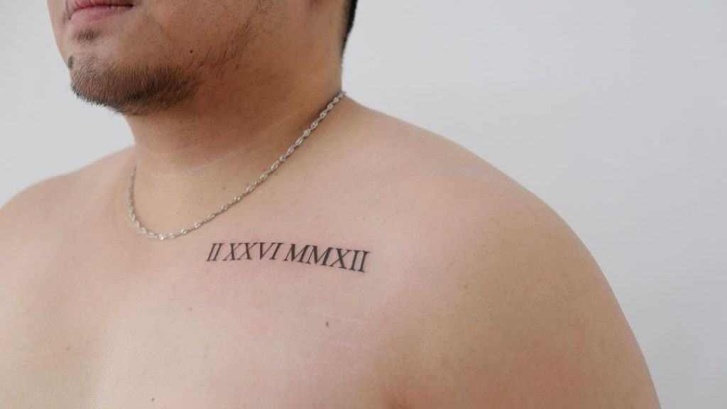Important Date Over Chest Small Tattoo