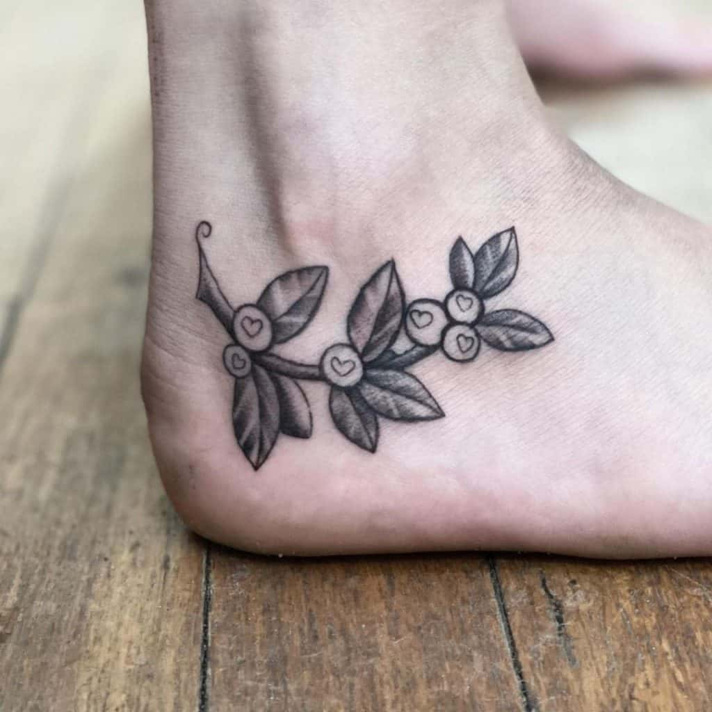Small Leaf Inspired Foot Tattoo