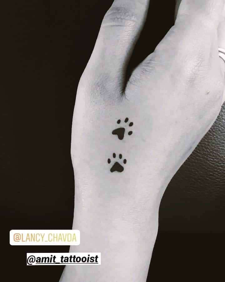 Two Black Dog Paws Tattoo On Hand