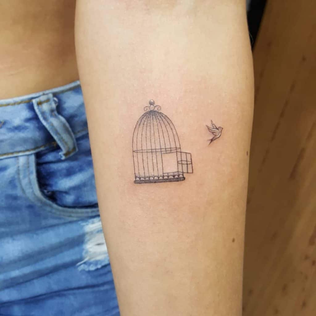 An Open Cage Tattoo 1
