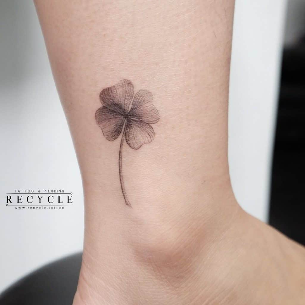 Small Black Flower Ankle Tattoo